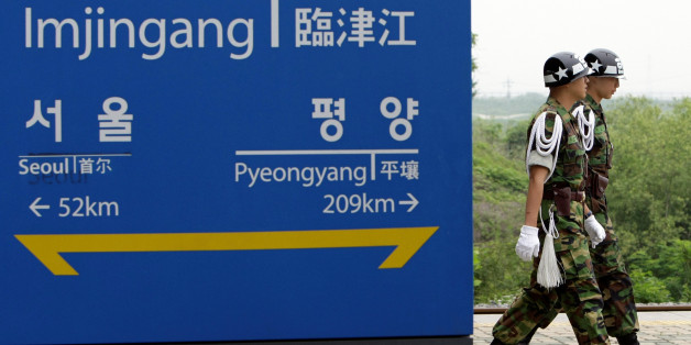 "South Korean military police officers walk by a sign showing the distance to the North Korean capital Pyongyang and South Korea's capital Seoul from Imjingang Station near the border village of Panmunjom that separates the two Koreas since the Korean War, in Paju, South Korea, Wednesday, June 17, 2009. North Korea warned Wednesday of a ""thousand-fold"" military retaliation against the U.S. and its allies if provoked, the latest threat in a drumbeat of rhetoric in defense of its rogue nuclear prog"