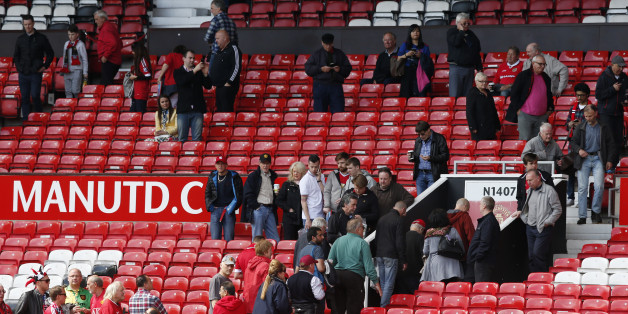 "Britain Soccer Football - Manchester United v AFC Bournemouth - Barclays Premier League - Old Trafford - 15/5/16Fans leave the ground as sections of the North Stand are evacuated before the matchReuters / Andrew YatesLivepicEDITORIAL USE ONLY. No use with unauthorized audio, video, data, fixture lists, club/league logos or ""live"" services. Online in-match use limited to 45 images, no video emulation. No use in betting, games or single club/league/player publications.  Please contact your account"