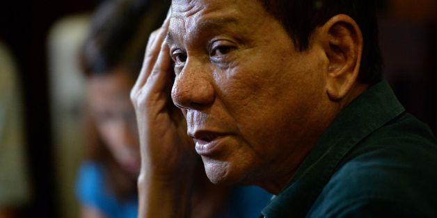 Philippines' President-elect Rodrigo Duterte, speaks to the media for the first time asince he claimed victory in the presidential election, at a restaurant in Davao City, on the southern island of Mindanao on May 15, 2016. Duterte vowed on May 15 to reintroduce capital punishment and give security forces 'shoot-to-kill' orders.  / AFP / TED ALJIBE        (Photo credit should read TED ALJIBE/AFP/Getty Images)