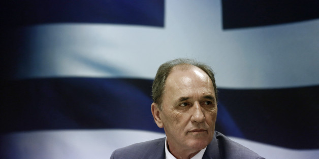 George Stathakis, Greece's economy minister, pauses during a news conference in Athens, Greece, on Wednesday, Sept. 23, 2015. The new government in Athens, named late on Tuesday, will have to immediately start implementing a wide slate of politically toxic austerity measures that will test its cohesion and could result in yet another election if enough lawmakers waver. Photographer: Kostas Tsironis/Bloomberg via Getty Images