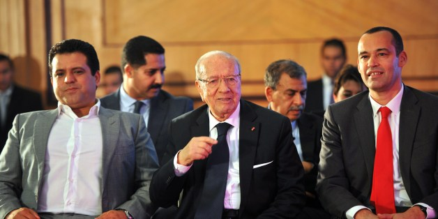 Tunisian former prime minister and presidential candidate, Beji Caid Essebsi looks on with the leader of the Free Patriotic Union (UPL) and former presidential candidate Slim Riahi (L), and leader of Afek Tounes Party Yassine Brahim (R) during Essebsi's presentation of his presidential program in Tunis on December 15, 2014. In the first round of polling last month Essebsi took 39.46 percent of votes cast among 27 candidates and Tunisia's incumbent President Moncef Marzouki 33.43 percent.   AFP PHOTO/ FETHI BELAID        (Photo credit should read FETHI BELAID/AFP/Getty Images)