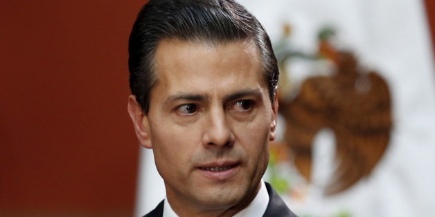 "Mexico's President Enrique Pena Nieto speaks during a news conference at the National Palace in Mexico City, Mexico January 8, 2016. The capture of most-wanted drug lord Joaquin ""El Chapo"" Guzman was the result of a months-long criminal and intelligence investigation, Pena Nieto said on Friday. Guzman, head of the powerful Sinaloa Cartel whom Pena Nieto first caught in February 2014, was captured in an early morning raid that killed five in the city of Los Mochis in the drug baron's native state"