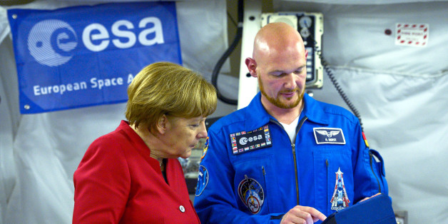 German Chancellor Angela Merkel (L) speaks with German astronaut Alexander Gerst in the Columbus Module as she visits the European Astronaut Centre (EAC), western Germany on May 18, 2016. REUTERS/ Sascha Schurmann/Pool
