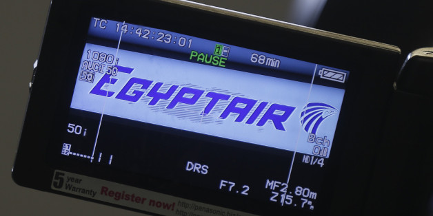 The company logo is displayed on a video camera screen at the Egyptair desk at Charles de Gaulle airport, after an Egyptair flight disappeared from radar during its flight from Paris to Cairo,  in Paris, France, May 19, 2016.  REUTERS/Christian Hartmann