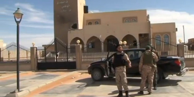 A still image from video released May 17, 2016 shows forces loyal to Libyan unity government outside the National Commercial bank after the recapture of Abu Grain, one of the main checkpoints south of the city of Misrata, Libya from Islamic State. MISRATA TV via REUTERS TV.  ATTENTION EDITORS - THIS PICTURE WAS PROVIDED BY A THIRD PARTY. EDITORIAL USE ONLY. REUTERS IS UNABLE TO INDEPENDENTLY VERIFY THIS IMAGE. NO RESALES. NO ARCHIVE. FOR EDITORIAL USE ONLY