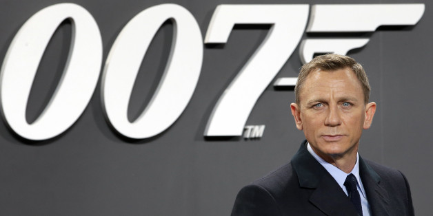 Actor Daniel Craig poses for the media as he arrives for the German premiere of the James Bond movie 'Spectre' in Berlin, Germany, Wednesday, Oct. 28, 2015. (AP Photo/Michael Sohn)
