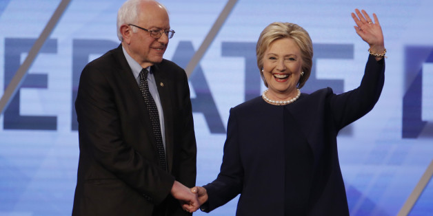 Democratic U.S. presidential candidates Senator Bernie Sanders and Hillary Clinton shake hands before the start of the Univision News and Washington Post Democratic U.S. presidential candidates debate in Kendall, Florida March 9, 2016.   REUTERS/Carlo Allegri