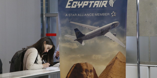 A reporter writes at the EgyptAir counter at Charles de Gaulle Airport outside of Paris, Thursday, May 19, 2016. An EgyptAir flight from Paris to Cairo with 66 passengers and crew on board crashed in the Mediterranean Sea early Thursday morning off the Greek island of Crete, Egyptian and Greek officials said. (AP Photo/Michel Euler)