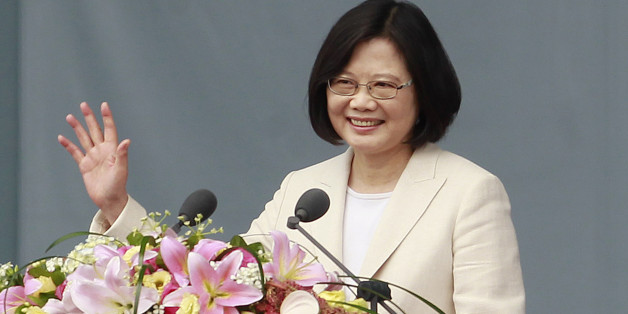 Taiwan's President Tsai Ing-wen waves to Taiwanese people as she delivers an acceptance speech during her inauguration ceremony in Taipei, Taiwan, Friday, May 20, 2016. Taiwan inaugurated Tsai as its first female president on Friday, returning the pro-independence Democratic Progressive Party to power amid new concerns over increasingly fractious relations with Beijing and a flagging economy. (AP Photo/Chiang Ying-ying)