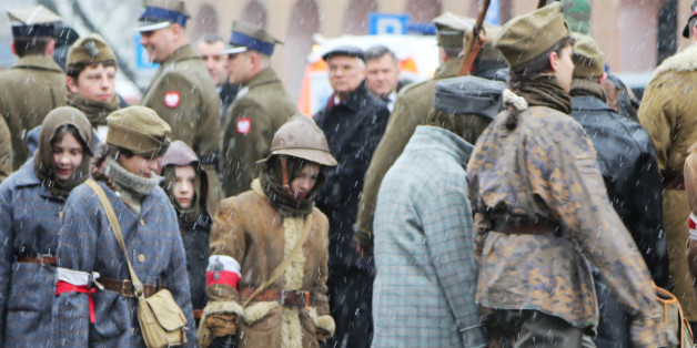 WARSAW, POLAND - 2016/03/01: Children dressed in different army style clothing from different era in Polish history march in front of the former communist detention center of the Ministry of Public Security (SB) in Warsaw, Poland. During the ceremony in front of the detention center, Polish President, Andrzej Duda laid flowers by a memorial commemorating all political prisoners who were tortured and murdered during the communist era in Poland. The memorial was part of the National Day of Remembrance Soldiers accursed. The National Day of Remembrance is for Polish soldiers, who were part of the anti-communist and independence underground. It was adopted in 2001, when the Polish parliament decided that, It recognized the merits of organizations and groups for independence, which after the Second World War, decided to take up the unequal struggle for sovereignty and independence of Polish, giving thus a tribute to the fallen and murdered and all the imprisoned and persecuted organization Freedom and Independence. (Photo by Anna Ferensowicz/Pacific Press/LightRocket via Getty Images)
