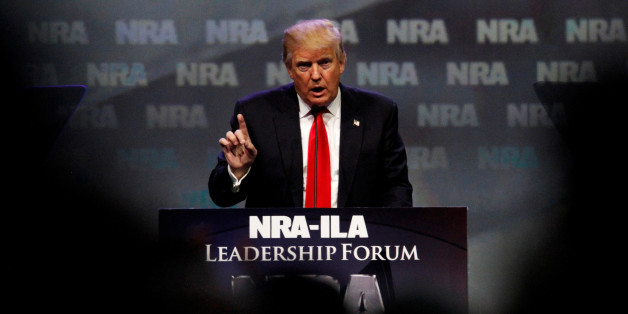 Republican presidential candidate Donald Trump addresses members of the National Rifle Association's during their NRA-ILA Leadership Forum during their annual meeting in Louisville, Kentucky, U.S., May 20, 2016. REUTERS/John Sommers II