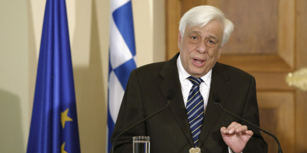 President of Greece, Prokopis Pavlopoulos, speaks to the media during a press conference after a meeting with Cyprus' President Nicos Anastasiades at the presidential palace in the capital Nicosia, Cyprus, Monday, March 30 , 2015. President of Greece Prokopis Pavlopoulos arrived in Cyprus for a two-day official visit, his first since assuming his duties. (AP Photo/Petros Karadjias)
