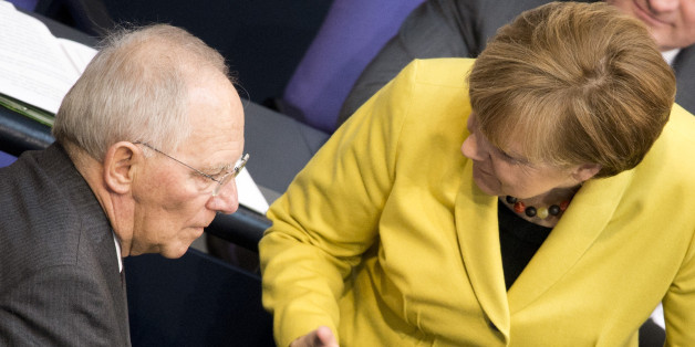 BERLIN, GERMANY - FEBRUARY 27: German Chancellor Angela Merkel and German Finance Minister Wolfgang Schaeuble  attend a debate due to the four-month-extension of the Greek bail-out programme on February 27, 2015 in Berlin, Germany. (Photo by Michael Gottschalk/Photothek via Getty Images)