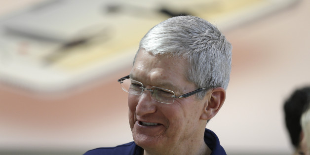 Apple CEO Tim Cook visits with customers at the Apple Store Thursday, March 31, 2016, in Palo Alto, Calif. The new Apple iPhone SE and 9.7 inch iPad Pro were available for sale on Thursday. (AP Photo/Eric Risberg)