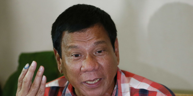 FILE- In this May 9, 2016, file photo, then front-running presidential candidate Mayor Rodrigo Duterte gestures during his second news conference after voting in a polling precinct at Daniel R. Aguinaldo National High School, Matina district, his hometown in Davao city in southern Philippines Monday, May 9, 2016. Presumptive Philippine President-elect Rodrigo Duterte said Monday he would offer Cabinet posts to communist rebels, move to amend the constitution to give more power to the provinces and reimpose the death penalty in some of his first policy pronouncements since winning last week's election based on an unofficial count. (AP Photo/Bullit Marquez, File)