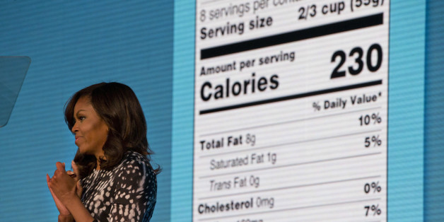 First lady Michelle Obama announces a makeover for food nutrition labels with calories listed in bigger, bolder type and a new line for added sugars, while speaking to the Building a Healthier Future Summit in Washington, Friday, May 20, 2016. (AP Photo/Jacquelyn Martin)