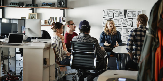 Businesswoman leading project meeting with coworkers in high tech startup office