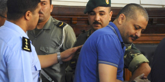Imed Trabelsi, a nephew of ousted Tunisian President, Zile El Abidine Ben Ali, right, arrives before court for a trial hearing in Tunis, Tunisia, Tuesday, Aug. 2, 2011.   A Tunisian court has granted defense lawyers' request to postpone the trial of 23 relatives and close collaborators of ousted Tunisian dictator Zine El Abidine Ben Ali. The defendants face charges including illegal possession of foreign currency, jewelry trafficking and attempted flight. If convicted, they could be sentenced to six months to five years in prison as well as hefty fines. (AP Photo/Hassene Dridi)