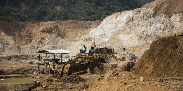 Miners work on a rock washing and separating machine at the Lian Shan open pit ruby mine in Mogok, Mandalay, Myanmar, on Tuesday, March 15, 2016. In a remote region of Myanmar, a country that is estimated to produce 90% of the world's ruby supply, there is a place where gem reigns supreme. Mogok, about 280 miles north of the capital Napyidaw, is economically reliant on mining, gem-cutting and jewelry making - giving it the title 'Ruby Land.' Photographer: Taylor Weidman/Bloomberg via Getty Images