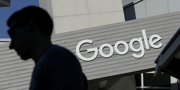"FILE - In this Nov. 12, 2015, file photo, a man walks past a building on the Google campus in Mountain View, Calif. Google said Wednesday, May 11, 2016, that it will ban ads from payday lenders, calling the industry ""deceptive"" and ""harmful."" Google said it will no longer allow ads for loans due within 60 days and will also ban ads for loans where the interest rate is 36 percent or higher. The ban is effective July 13. (AP Photo/Jeff Chiu, File)"