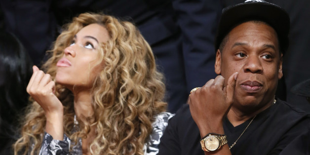 Singer Beyonce and her husband Jay-Z sit courtside before the NBA All-Star basketball game in Houston, Texas, February 17, 2013. REUTERS/Lucy Nicholson (UNITED STATES  - Tags: SPORT BASKETBALL)