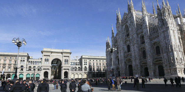 Italian Carabinieri officers stand at the Duomo's square downtown Milan, Italy, February 21, 2016. Picture taken on February 21, 2016. REUTERS/Stefano Rellandini