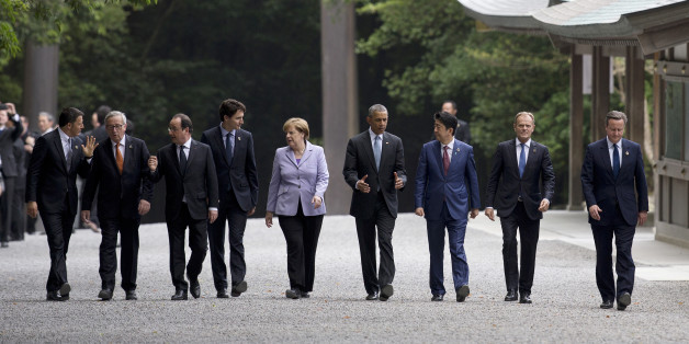 From left, Italian Premier Matteo Renzi, European Commission President Jean-Claude Juncker, French President Francois Hollande, Canadian Prime Minister Justin Trudeau, German Chancellor Angela Merkel, U.S. President Barack Obama, Japanese Prime Minister Shinzo Abe, European Council President Donald Tusk, and British Prime Minister David Cameron, walk past the Kaguraden as they visit Ise Jingu shrine in Ise, Mie Prefecture, Japan, Thursday, May 26, 2016, as part of the G-7 Summit. (AP Photo/Carol