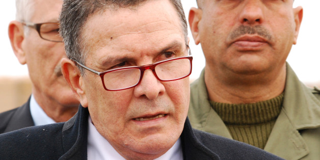 Tunisian Defence minister Farhat Horchani,  attends a presentation of the so-called obstacle system, aimed at preventing Islamists militants from entering the Tunisian territory, Saturday Feb.6, 2016 in near Ben Guerdane, eastern Tunisia, close to the border with Libya . (AP Photo/Benjamin Wiacek)