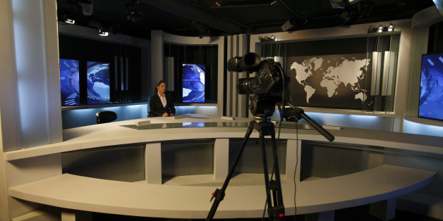 Nourelyakin Meghrich, an Ennahar TV News anchorwoman is seen at a TV news studio in Algier May 8, 2012. In the past few months, several independent Algerian television channels have started broadcasting, undermining the monopoly of state television. The new stations were set up after President Abdelaziz Bouteflika, under pressure to reform after the ?Arab Spring? uprisings in neighbouring states, promised to open up the country?s tightly-controlled electronic media. REUTERS/Zohra Bensemra (ALGER