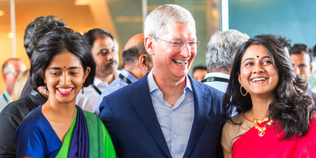 In this Handout photograph provided by Apple Media office, Apple chief Tim Cook talks with Indian colleagues during the inauguration of the Apple's Map development office in Hyderabad, India, Thursday, May 19, 2016. Apple will set up an app design and development center in southern India, the company announced Wednesday, shortly after company chief Tim Cook arrived in the country on his first visit. (Noel David/Apple via AP)