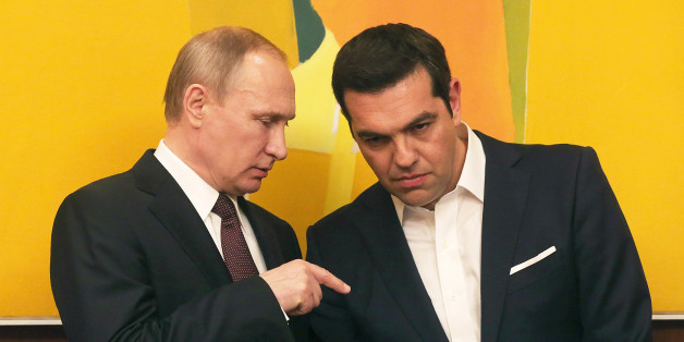 Greek Prime Minister Alexis Tsipras , right, chats with Russian President Vladimir Putin during their meeting in Athens, Friday, May 27, 2016.  On his first trip to a European Union country this year, Russian President Vladimir Putin traveled to Greece Friday to visit a secluded Christian Orthodox monastic sanctuary and eye energy and privatization deals in the cash-strapped country.(Orestis Panagiotou/EPA via AP)