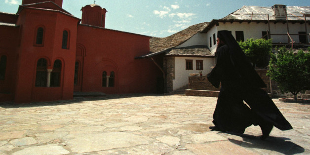 An Orthodox monk walks in courtyard of a monastery of autonomous community of Mount Athos in northern Greece May 10. Portuguese Prime Minister Antonio Guterres visited monasteries of Mount Athos during his semi-official three-day visit to Greece.