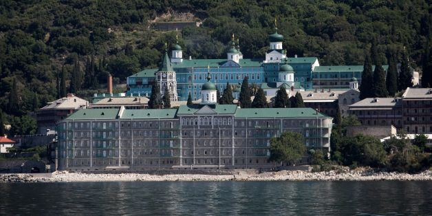 A photo taken on May 28, 2016 shows the Russian St. Panteleimon Monastery, in Mount Athos on 28 May, 2016 where the President of the Russian Federation Vladimir Putin will visit. Russian President is visiting Mount Athos in Greece to mark the 1,000-year presence of Russian Orthodox monks there. Russian President Vladimir Putin signed several economic deals with Athens on on May 27, 2016 during a visit to Greece aimed at reinforcing a relationship with one of his few friends in the EU amid tensio