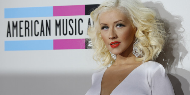 Musician Christina Aguilera arrives at the 41st American Music Awards in Los Angeles, California November 24, 2013.  REUTERS/Mario Anzuoni  (UNITED STATES - TAGS: ENTERTAINMENT)(AMA-ARRIVALS)