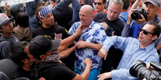 Trump supporters and anti-Trump demonstrators clash outside a campaign event for U.S. presidential candidate Donald Trump in San Diego, California, U.S. May 27, 2016.  REUTERS/Jonathan Alcorn