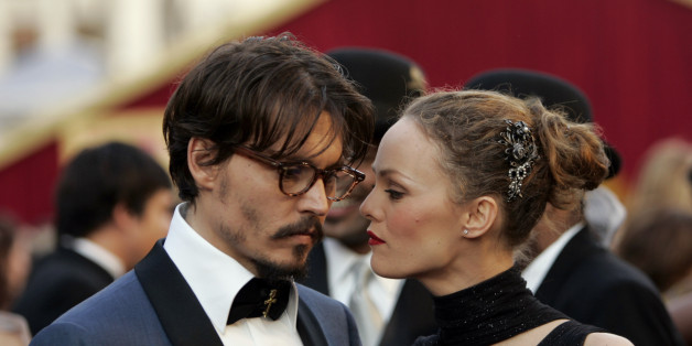 "Johnny Depp shares a moment with his partner, French actress Vanessa Paradis, as they arrive atthe 77th Academy Awards Sunday, Feb. 27, 2005, in Los Angeles. Depp is nominated for an Oscar for best actor in a leading role for his work in ""Finding Neverland.""  (AP Photo/Kevork Djansezian)"
