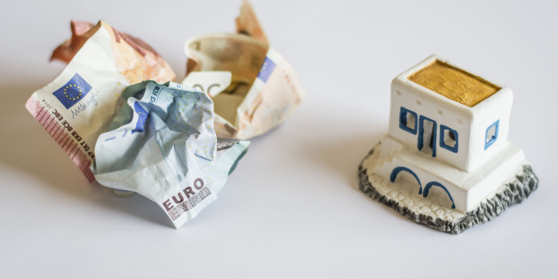 """The shoot is topical as it represents Greece debt crisis using Euro banknotes and a typical Greek little house. The crumpled banknotes represent Greek money crunch and also the possibility Greece goes out of the Euro zone. The focus is on the word """"Euro"""" and its translation into greek letters."""