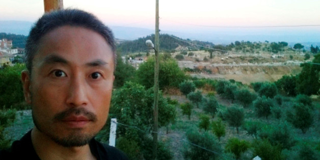 """Japanese journalist Jumpei Yasuda, who is seen in this photo sent by e-mail to a Kyodo News photographer on June 23, 2015 before Yasuda's departure to Syria, with the message reading, """"I will smuggle myself into Syria from now"""", is seen in this undated photo released by Kyodo on December 24, 2015.  Mandatory credit Kyodo/via REUTERS/File Photo  ATTENTION EDITORS - THIS IMAGE WAS PROVIDED BY A THIRD PARTY. EDITORIAL USE ONLY. MANDATORY CREDIT. JAPAN OUT. NO COMMERCIAL OR EDITORIAL SALES IN JAPAN."""