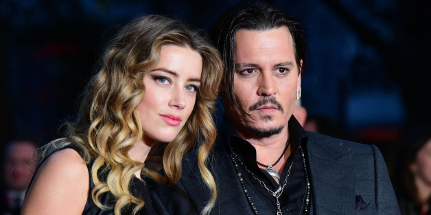 "Photo by: KGC-42/STAR MAX/IPx 10/11/15 Amber Heard and Johnny Depp at the premiere of ""Black Mass"". (London, England, UK)"