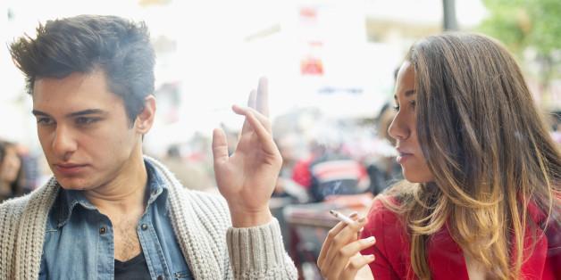Nonsmoker Man and Smoker Young Woman