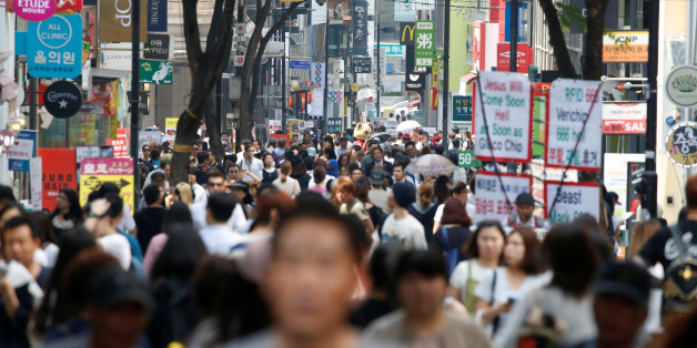 People walk in Myeongdong shopping district in Seoul, South Korea, May 31, 2016.  REUTERS/Kim Hong-Ji