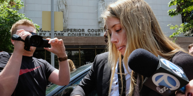 Actress Amber Heard leaves Los Angeles Superior Court court on Friday, May 27, 2016, after giving a sworn declaration that her husband Johnny Depp threw her cellphone at her during a fight Saturday, striking her cheek and eye. The judge ordered Depp to stay away from his estranged wife and ruled that Depp shouldn't try to contact Heard until a hearing is conducted on June 17. Heard filed for divorce on Monday. (AP Photo/Richard Vogel)