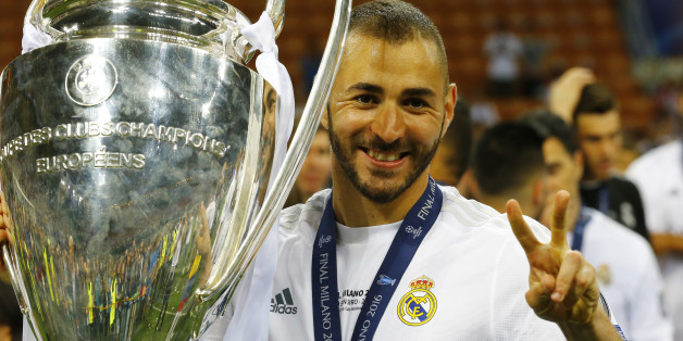 Soccer Football - Atletico Madrid v Real Madrid - UEFA Champions League Final - San Siro Stadium, Milan, Italy - 28/5/16Real Madrid's Karim Benzema celebrates with the trophy after winning the UEFA Champions LeagueReuters / Stefano RellandiniLivepicEDITORIAL USE ONLY.