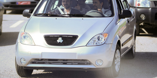EDITORS' NOTE: Reuters and other foreign media are subject to Iranian restrictions on leaving the office to report, film or take pictures in Tehran. Iran's President Mahmoud Ahmadinejad (R) drives an Iranian-made car called Tiba, during the opening ceremony of the Iranian Saipa automaker factory in Kashan, 258 km (161 miles) south of Tehran, May 9, 2010. REUTERS/Fars News/Mehdi Marizad (IRAN - Tags: TRANSPORT POLITICS BUSINESS)   QUALITY FROM SOURCE