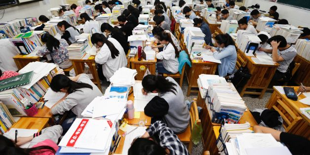 This photo taken on May 24, 2016 shows senior high school students studying at night to prepare for the college entrance exams at a high school in Lianyungang, east China's Jiangsu province.   The three-day 2016 college entrance exam will start on June 7. / AFP / STR / China OUT        (Photo credit should read STR/AFP/Getty Images)