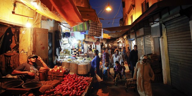 "People shop for food in a narrow street of Rabat's Medina September 25, 2014. UNESCO made Rabat a World Heritage Site two years ago and media and tour operators call it a ""must-see destination."" But it seems the tourist hordes have yet to find out. While visitors are getting squeezed through the better-known sites of Marrakesh and Fez, the old part of Rabat - with its beautiful Medina and Kasbah of the Udayas - remains an almost unspoiled oasis of calm. Smaller and more compact, its labyrinths o"