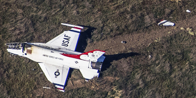 An Air Force F-16 with the Thunderbirds air demonstration squadron sits crashed in a field 4 miles south of Colorado Springs after performing a fly-by of the U.S. Air Force Academy graduation ceremony where President Barack Obama gave the commencement address, in Colorado Springs, Colorado, U.S. June 2, 2016.  REUTERS/John Wark