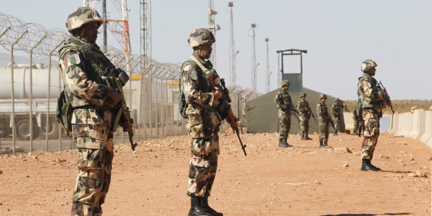 Algerian soldiers are seen at the Tiguentourine Gas Plant in In Amenas, 1600 km (994 miles) southeast of Algiers, January 31, 2013. REUTERS/Louafi Larbi (ALGERIA - Tags: MILITARY POLITICS CRIME LAW)