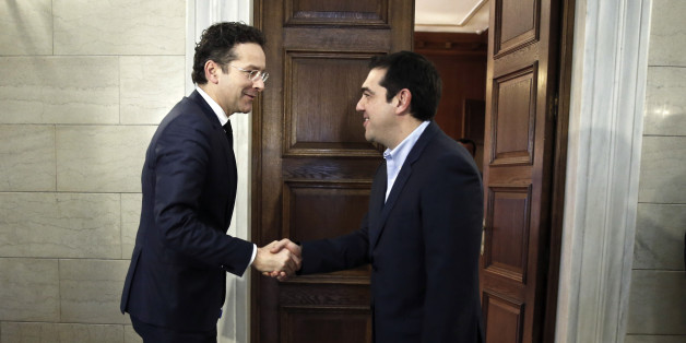 Jeroen Dijsselbloem (L), head of the euro zone finance ministers' group, is welcomed by Greece's Prime Minister Alexis Tsipras at his office in Athens, January 30, 2015. Dijsselbloem said on Thursday the new Greek government led by the left-wing, anti-bailout Syriza party, could derail reforms and economic recovery if it sticks to its election campaign promises. REUTERS/Petros Giannakouris/Pool  (GREECE - Tags: POLITICS BUSINESS)