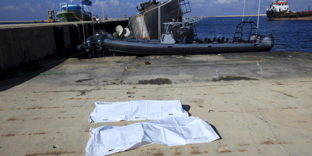 Bags containing a body of two migrants, who died after a boat sank off the coast, lay in a navy base in Tripoli, Libya, December 21, 2015. REUTERS/Ismail Zitouny